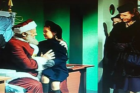 Girl jumps into Santa's lap