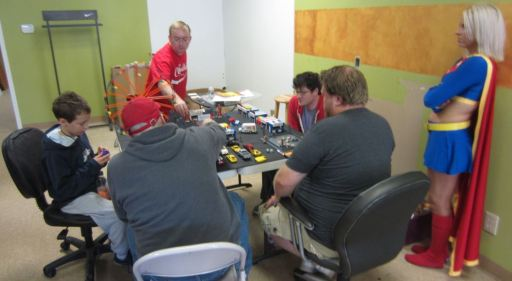 JP leading up the game room with Zombie Daze at Elite Comics 2013