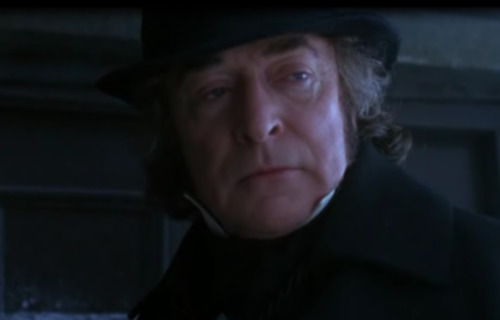 Michael Caine as Ebenezer Scrooge