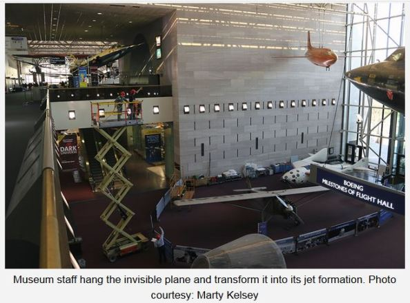 NASM staff installing Lt Diana Prince donated plane