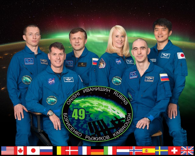 Expedition 49 official crew portrait with 47S crew (Anatoli Ivanishin, Kate Rubins, Takuya Onishi) and 48S crew (Shane Kimbrough, Andrei Borisenko, Sergei Ryzhikov). Photo Date: January 13, 2016. Location: Building 8, Room 183 - Photo Studio. Photographer: Robert Markowitz