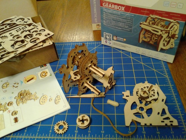 The five laser-cut sheets of plywood, punch-out tool, and wax are all you need to build this gearbox.