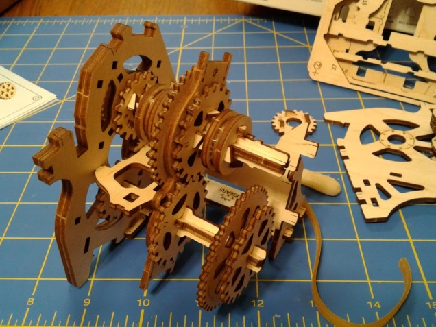"""The project about two-thirds complete. The rubber band is not a belt, it's cut into pieces to form """"feet"""" to keep the final model in place."""